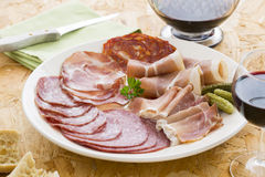 Platter of different ham Meat, salami and gherkin Royalty Free Stock Photo