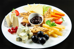 Platter with different types of cheese Stock Images