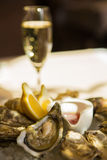 A platter of fresh organic raw oysters on ice. At restaurant Stock Photography