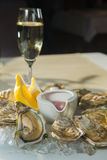 A platter of fresh organic raw oysters on ice. At restaurant Royalty Free Stock Photo