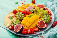 Platter fruits and berries. Vegan cuisine. Dietary menu Stock Photo