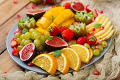 Platter fruits and berries. Vegan cuisine. Dietary menu Royalty Free Stock Photos