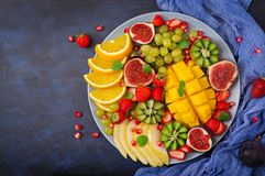 Platter fruits and berries. Vegan cuisine. Dietary menu. Flat lay. Top view Stock Photography