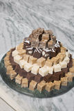 Platter of Fudge. Assorted flavours on a marble surface Royalty Free Stock Images