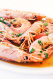 Platter full of shrimp served with parsley Stock Photo