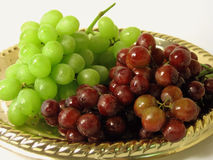Platter of Grapes. Red and green grapes on gold platter royalty free stock images