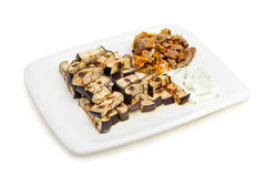 Platter of grilled eggplant with tzatziki sauce Royalty Free Stock Images