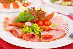 Platter of  ham slices and sausages Royalty Free Stock Photography