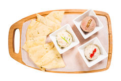 Platter with italian focaccia and various pates. Royalty Free Stock Image