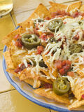 Platter of Nachos with Salsa Jalapenos and Cheese stock images