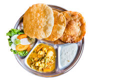 Platter of Nepali puri bread with dhal and yogurt isolated in white Stock Photo