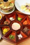 Platter of nine delicacies Stock Images