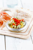 Platter of olives,  Cured Meat, Ciabatta om white wood Royalty Free Stock Photography
