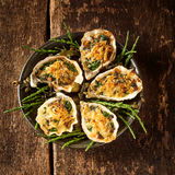 Platter of Oysters with Gratin Topping on Table Royalty Free Stock Photography