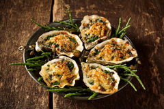 Platter of Oysters with Gratin Topping on Table stock images