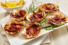 Platter of Oysters Kilpatrick Served with Lemon Royalty Free Stock Images