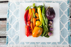Platter of Rainbow Assorted Vegetables on barn table Royalty Free Stock Photos