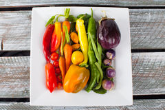 Platter of Rainbow Assorted Vegetables on wood table Stock Photography