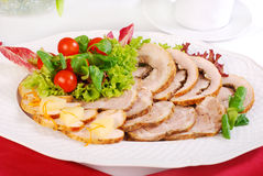 Platter of  roasted meat slices. Platter of various  roasted meat slices with lettuce and tomato  decoration Stock Image