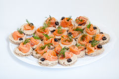 Platter with sandwiches with salmon Royalty Free Stock Photography