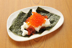 Platter of seaweed with salmon roe and plain rice in traditional Stock Images