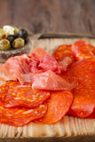 Platter of serrano jamon Cured Meat,  chorizo and olives Stock Photo