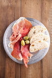 Platter of serrano jamon Cured Meat, Ciabatta, chorizo and olive Stock Image