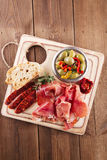 Platter of serrano jamon Cured Meat, Ciabatta, chorizo and olive Royalty Free Stock Photography
