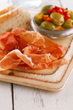 Platter of serrano jamon Cured Meat and ciabatta Royalty Free Stock Image