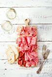 Platter of serrano jamon Cured Meat and ciabatta Stock Photo