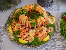 Platter of shrimp. Big plate of shrimp on a table with white tablecloth Royalty Free Stock Images
