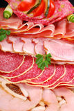 Platter of sliced ham,salami and cured meat Stock Images