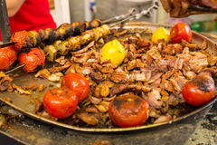 Platter of sliced roast meat and tomatoes Stock Image