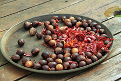 Platter of spice nutmeg. An image of a plate of nutmeg spice served in a round shallow plate stock photography