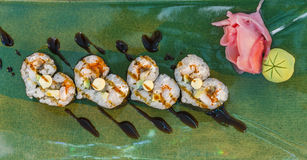 Platter of sushi rolls sprinkled with seeds Stock Image