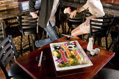 Platter of sushi on table in Japanese restaurant Royalty Free Stock Photos