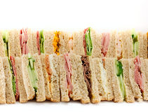A Platter of Triangular Sandwiches. A selection of Sandwiches with various fillings at a buffet with text area Stock Images