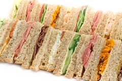 A Platter of Triangular Sandwiches. A selection of Sandwiches with various fillings at a buffet with text area Royalty Free Stock Images