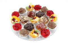 Platter with variations of small cakes with different stuffing Royalty Free Stock Photos