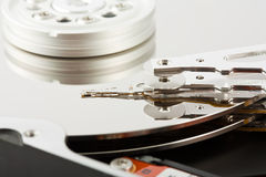 Platters and head of a computer hard drive Royalty Free Stock Photos