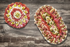 Platters Of Serbian Traditional Savory Appetizers Dishes Meze Served On Old Cracked Flaky Garden Table. Two Platters of Serbian Traditional Savory Antipasto Meze Royalty Free Stock Photography