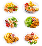 Plattor av den olik kött, fisken och höna Arkivfoton