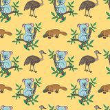 Platypus,Ostrich,Koala. Eucalyptus tree branches.Australian animal.Vector illustration for children.Seamless pattern.Cute cartoon on a yellow background.Print Stock Photography