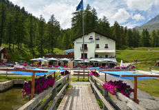 Restaurant Murtarol on the shore of the Sils Lake. Plaun da Lej, Grisons, Switzerland - JULY 27, 2017. Restaurant Murtarol on the shore of the Sils Lake, near Royalty Free Stock Photography