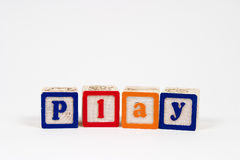 Play. Spelled out in block letters royalty free stock photo