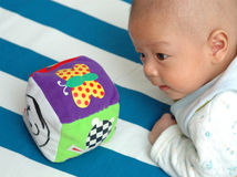 Play. A chinese infant is palying with his toy, his eyes focus on the toy Stock Photos