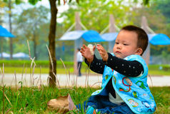 Play alone Baby(Asia, China, Chinese). Parents don't every moment of every day to take care of their children, and to leave them alone, to entertain the children stock photo