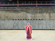 Play the ancient people. A caucasian man standing behind an ancient Ming Dynasty traditional clothing prop inside the Xi'an Circumvallation shanxi province Stock Images