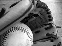 Play ball. Baseball and leather glove. Black and white image Royalty Free Stock Photography