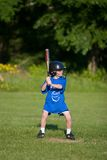 Play Ball. Young boy playing little league Royalty Free Stock Photography